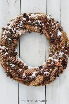 This rustic pinecone wreath is even more charming when displayed outside, dusted with snow. Follow our pinecone wreath tutorial to recreate this holiday wreath for your home. If hung outdoors, let the wreath dry completely before storing it. #marthastewart #christmas #diychristmas #diy #diycrafts #crafts