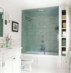 ideas witching small bathroom design with tub and shower using green ceramic wall tiles including clear glass panels alongside white linen storage cabinet with 5 tier shelving unit