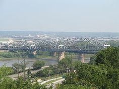 Broadway Bridge  Carries US 169  Crosses  Missouri River  Locale  Kansas City, Missouri to North Kansas City, Missouri  Design  Through arch bridge  Opened  September 9, 1956      Coordinates  39°06′45″N 94°35′23″W / 39.112475°N 94.589647°W / 39.112475; -94.589647Coordinates: 39°06′45″N 94°35′23″W / 39.112475°N 94.589647°W / 39.112475; -94.589647      The Broadway Bridge is a through arch bridge that spans the Missouri River in Kansas City, Mi