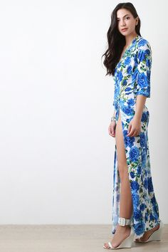 @modaonpoint This alluring dress features floral print, surplice front, long bishop sleeves, high side slit, and maxi length. Accessories sold separately. Made in U.S.A. 95% Polyester, 5% Spandex.