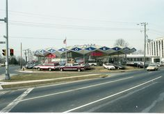 Arlington in the '80s - a gallery on Flickr.  Peck Chevrolet at the crossroads of Glebe Rd and Wilson Blvd.