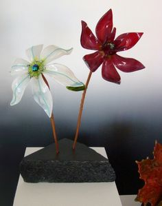 """Local+soapstone+makes+the+perfect+base+for+this+fused+glass+flower+sculpture+entitled+""""The+Garden"""".+I+hand+select+the+soapstone+from+the+quarry,+drill+it,+then+sand+it+and+finish+it+to+bring+out+the+natural+color.+The+stone+is+all+local-+from+the+last+remaining+soapstone+quarry+in+the+U.S.+Other+quarries+import+from+[...]"""