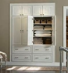 Built in Linen Cabinet. I really like this look. Lots of space Maybe one more drawer on bottom instead of short cabinet at top