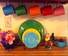 I added these cup hooks beneath a kitchen cabinet to display some of my Fiestaware mugs:  peacock, shamrock, tangerine, scarlet and rose, along with a plum teapot, shamrock, sunflower and turquoise plates, vintage rooster and turquoise sugar with cobalt lid