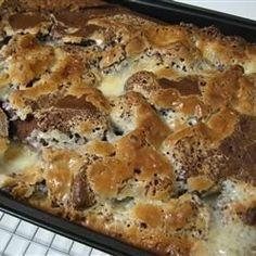 An easy and delicious cake, also known as Earthquake Cake. Coconut and pecans are baked under a German chocolate cake mix, with a cream cheese mixture on top that sinks into the batter as it bakes.
