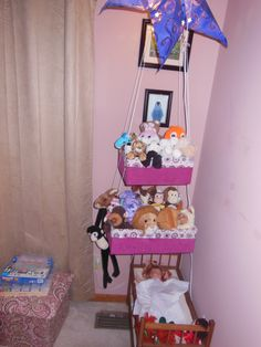 Stuffed Animal Storage.  Covered these boxes and made a liner, Hubby put in rivets and hung from ceiling.  Loaded with toys