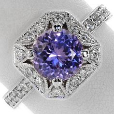 GORGEOUS!!!!! <3  On the fence of whether or not it LOOKS like an engagement ring or not…. (custom)