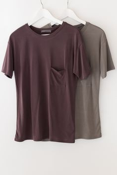 - Simple t-shirt with a small front chest pocket - Short sleeves - Loose fit - Super soft knit material - Available in Olive or Burgundy - 73% Modal 27% Polyester - Made in USA More