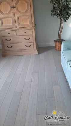 White hardwood floors for beach house interior design // Rustic Beachwood bamboo flooring // Living room flooring ideas
