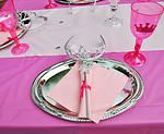The perfect princess party table setting - silver platter, silverware decorated with a sparkling wand, matching tiara, napkin and a pink sparkly crown plastic goblet