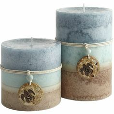 I'm in love with these!!! I want to get them for my mantel as they work perfectly with my colour scheme in my living room!!!  Sea Air Layered Pillars @ pier 1