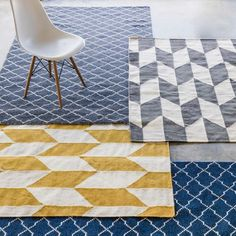 Layer geometric rugs in different colours to give a room a quick lift Geometric Cushions, Geometric Rug, Navy And White Rug, White Rugs, Navy Home Decor, Geometric Furniture, Geometric Shelves, Dry Carpet Cleaning, Cosy Room