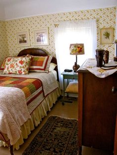 Love the kitschy, quaint style of this room with coved ceiling, wallpaper and small size. Great kids' room.