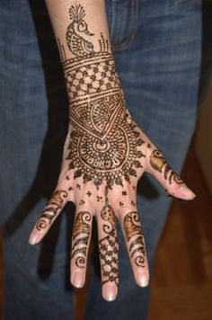 I just love henna. Henna is always at Indian weddings. You draw the henna, then you leave it on and put lemon juice mixed with sugar on it to make it darker when you take it off. Henna Hand Designs, Eid Mehndi Designs, Peacock Mehndi Designs, Indian Henna Designs, Bridal Henna Designs, Latest Mehndi Designs, Mehndi Designs For Hands, Hand Mehndi, Henna Mehndi