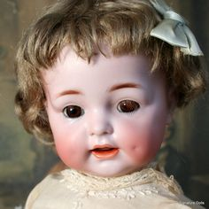 A wonderful and happy Kammer & Renihardt 122 Toddler sold by Signature Dolls.