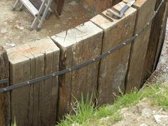 How to build a retaining wall with railway sleepers . - How to build a retaining wall with railway sleepers … – How to bui - Wooden Retaining Wall, Sleeper Retaining Wall, Building A Retaining Wall, Railroad Tie Retaining Wall, Railway Sleepers Garden, Oak Sleepers, Landscaping Retaining Walls, Backyard Landscaping, Landscaping Ideas