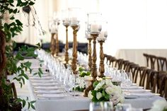 Elegant Carved Candlestands    Photography: Beale %26 Wittig   Read More:  http://www.insideweddings.com/weddings/luxurious-rustic-wedding-at-lakeside-country-club-in-wisconsin/721/