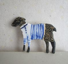 You have to love this black sheep wearing white Breton Stripes - Handformed and Handpainted Porcelain Brooch