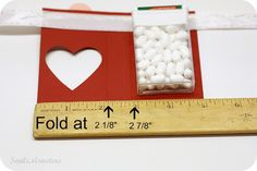Smilemonsters: Tic Tac Valentine Cut 3.5 x 5 and then fold at said markers. Awesome idea