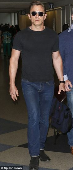 Incognito: Daniel Craig and Javier Bardem looked a far cry from their Skyfall alter egos as Daniel jetted into LAX and Javier touched down in New York on Sunday