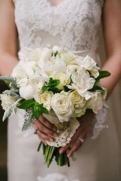 Bridal Bouquet filled with garden roses, gardenias, ranunculus, dusty miller, and ivy with lace handle. Floral by Le FLEUR Memphis