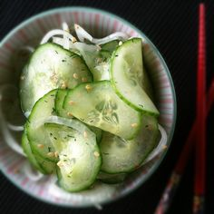 Asian Marinated Cucumber Salad  1 large English (seedless) cucumber, very thinly sliced  ¼ of a sweet onion, very thinly sliced  1/3 cup rice vinegar  1 tablespoon toasted sesame seeds  1 tablespoon minced fresh dill or ½ teaspoon dried dill weed  ¾ teaspoon salt  3/4 teaspoon sugar  ¼ teaspoon crushed red pepper flakes