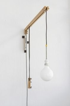Lamp With Weight: http://www.kanndesign.com/fr/product/applique-design-weight