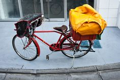 Japanese postal bicycle features short string ties tucked into the handlebars. Captured by Jan Chipchase.