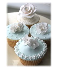 Beautiful Cake Pictures: Pretty Pale Blue Icing Cupcakes With Sugar Flowers: Cupcakes, Cupcakes With Flowers, Cupcakes With Icing