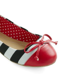 Flats. Black and white stripes. Red toe. Bows.