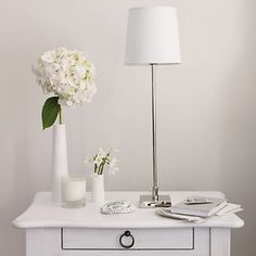 white, love this for simple Martha Stewart look. Add crystal lamp and a few trinkets for my style. Living room.