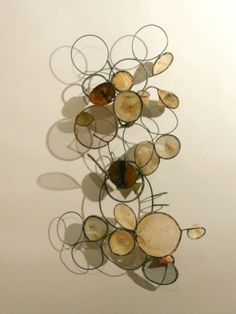 #Sculpture of circles casting shadows by Rickie Wolfe. This would look sweet in my living room!