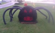 This is a picture of a spider made from a round bale of hay and some painted pool noodles. Pretty cool...not my pic but one from a FB friend