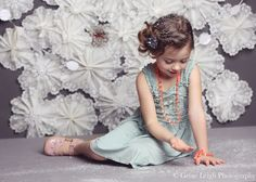 Megan, a photographer, got double-duty use out of her backdrop. Naturally she paired up the background with that adorable Matilda Jane Clothing Emilia Dress ($46) and Orange Beaded Necklace/Bracelet ($7) for her daughter's fifth year photo shoot. What a great idea! Source: Genie Leigh Photography