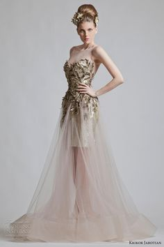 Sequinned dress with illusion neckline and skirt with sheer overlay. Krikor Jabotian.