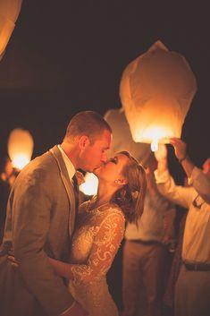 12 Magic Photos With Sky Lanterns For Your Wedding Album ❤ sky lanterns romantic kiss bride and groom city light studio ❤ See more: http://www.weddingforward.com/sky-lanterns/ #weddingforward #wedding #bride #WeddingPhoto #SkyLanterns
