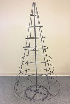 Metal floor spinning display tree perfect for displaying ornaments, hand towels, scarves and more! Large Christmas Ornaments, Diy Christmas Lights, Metal Christmas Tree, Cone Christmas Trees, Christmas Tree Crafts, Outdoor Christmas Decorations, Modern Christmas, Alternative Christmas Tree, Thanksgiving Diy