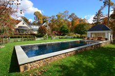 Swimming Pools Built On Slopes Above Ground Swimming Pool On Sloping Ground With Stone Wall To