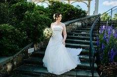 Just like a princess, Danielle floats down the steps to the Secret Garden where she exchanged vows with Rob in September 2012.