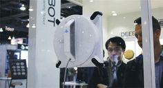 China's in-home robot maker, Ecovacs Robotics, brought new floor and window robots, and prototypes of its air purifier, home entertainment and security robots to this year's Consumer Electronics Show in Las Vegas. Las Vegas Shows, Home Entertainment, Robot, America, Entertaining, Marketing, Robotics, Robots, Usa