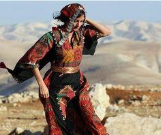 Palestinian girl wearing national folklore dress Thoub