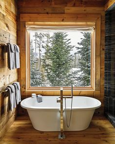 The view from the bath at Sky High and Halfway House, Big Sky, Montana – By Douglas Friedman - Go Inside Ken Fulk's Magical World #LogHomes #LogHomeDecorating