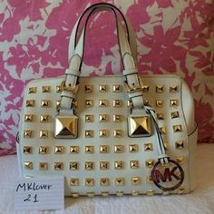 "Michael kors pyramid studded grayson Michael Kors Grayson Studded Leather Medium Satchel Handbag   White saffiano leather with neatly aligned golden studs on front and back. Golden hardware. Buckled top handles, 5"" drop. Removable chain and leather shoulder strap, 22""L. Top zip. Logo medallion hangs on front. Snap-button side pockets. Inside, monogram satin lining with one zip and four open pockets. 10""H x 14""W x 5 1/2""D Metal feet protect bottom. Michael Kors Bags"