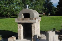 The Perfect Pizza Oven!  This oven was built using the Cortile Barile foam pizza oven forms and finished with a grey tile veneer.  To see more pictures of this oven (and many more ovens), please visit - BrickWoodOvens.com