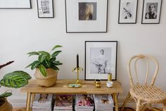 Victoria's favourite furniture from IKEA HUS Story #5: SKOGSTA bench with golden decoration and framed fashion photographs, next to which is the VIKTIGT rattan chair.