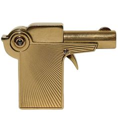 Cartier Gold Gun Pocket Lighter | From a unique collection of antique and modern tobacco accessories at https://www.1stdibs.com/furniture/more-furniture-collectibles/tobacco-accessories/