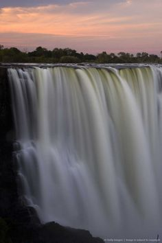The Victoria Falls or Mosi-oa-Tunya (the Mist that Thunders) is a waterfall located in southern Africa on the Zambezi River between the countries of Zambia and Zimbabwe. The falls are some of the largest in the world.