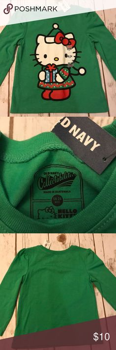 Toddler Girl Old Navy Hello Kitty Christmas Shirt NWT! Old Navy brand hello kitty Christmas shirt. Sized 18-24 months per tags. Long sleeve green tee shirt with hello kitty on it. Smoke free home Old Navy Shirts & Tops Tees - Long Sleeve