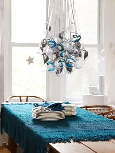 10 Simple Christmas Decorating Ideas for Small Spaces - If you haven't got a chandelier at all — why not just hang something from the ceiling? Think of it as a sort of upside-down Christmas tree Coastal Christmas, Noel Christmas, Christmas And New Year, Simple Christmas, Christmas Bulbs, Christmas Crafts, Holiday Ornaments, Xmas Baubles, Turquoise Christmas