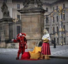 Jester and King at the gate of Prague castle, Czechia . Photo by Irena Brožová #prague #city #czechia